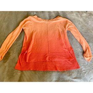 Bright orangey-pink long sleeve shirt